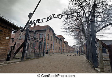 Gates to Auschwitz Birkenau Concentration Camp, Poland -...