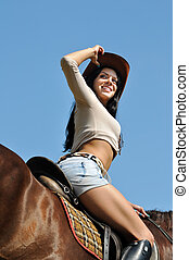 young attractive  woman and horse in sunny day