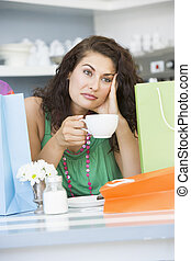 A young woman drinking tea in a cafe