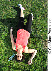 athlete tired and lying on the grass
