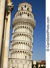 The famous Leaning Tower in Pisa on cloudy sky background