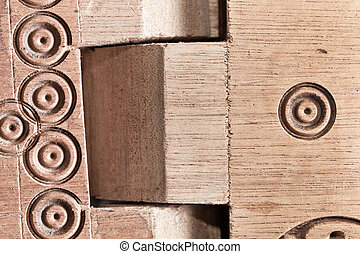 Wood carving - Close up of a carved wooden folding table