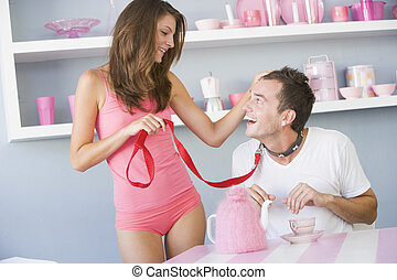 Couple role playing with dog leash