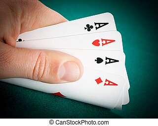winning playing cards in a man hand