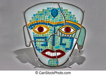 Colorful mask of stained glass - photo of an object