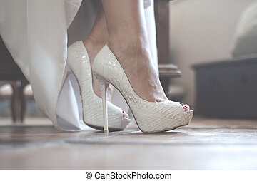 wedding shoes - The bride puts on beautiful wedding shoes