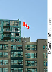 Canadian flag on roof of building