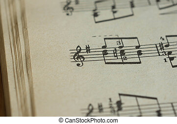 Fragment of the page of the old musical textbook close up