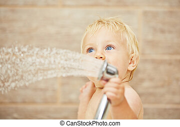 Baby in the bathroom - Blond baby taking shower in the...