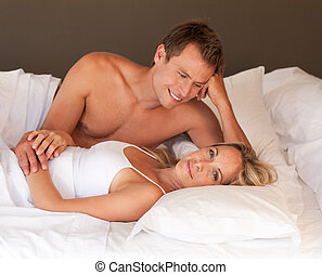 Intimate young couple on bed relaxing