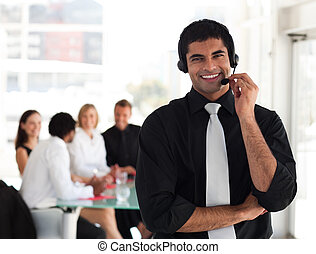 Business man talking on a headset - Young Businessman...