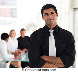 Business leader in front of his Team - Young Business leader...