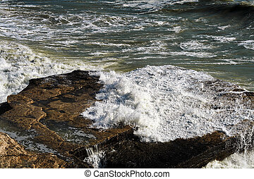 Caspian Sea. - Rocky shore of the Caspian Sea during the...