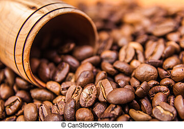 coffee beans in a wooden cup