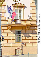 Embassy building with security cameras and windows, French...