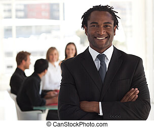Senior business leader standing and smiling in front of his...