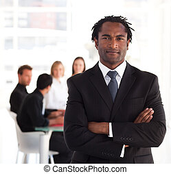 Portrait of a business leader standing in front of his...