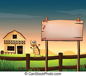 An empty wooden signboard near the fence at the farm -...