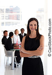 Young Confident business woman in front of team