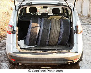 set of tires in trunk of car