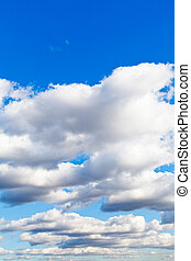 white clouds in blue spring sky