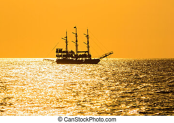silhouette of the ancient ship at sunset