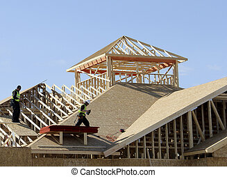 carpenters on the roof - carpenters on a roof of a new...