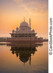 view of a putra mosque during sunrise at Putrajaya