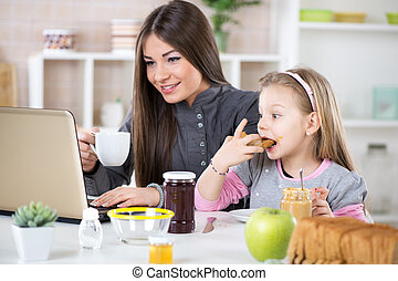 Breakfast before work - Business Woman and her daughter...