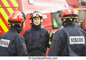 A firefighter giving instructions to her team