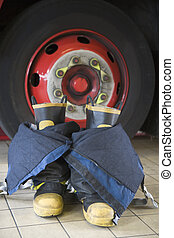 Firefighters boots and trousers in a fire station