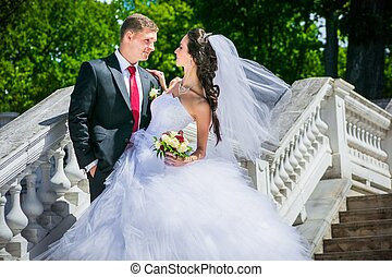 beautiful bride with groom - portrait of young wedding...