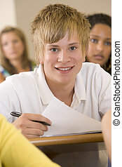 Male college student in a university lecture hall