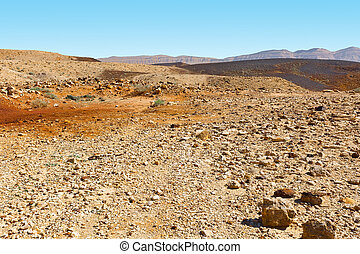 Israel Landscape - Stones of Grand Crater in Negev Desert,...