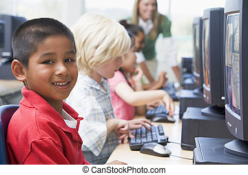 Kindergarten children learning how to use computers