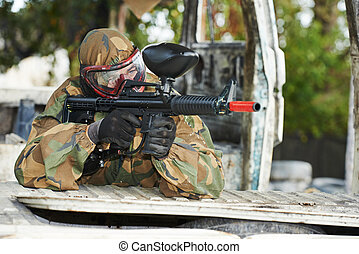 paintball player - Adrenalin paintball player in protective...