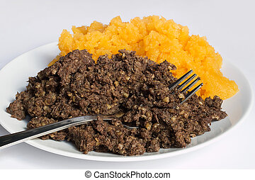 Haggis and neeps detail - Traditional haggis and neeps close...
