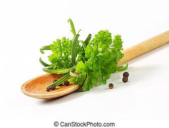 Fresh culinary herbs and black peppercorns