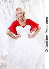 Trying a wedding gown on
