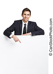 Businessman pointing hand gestures at copy space
