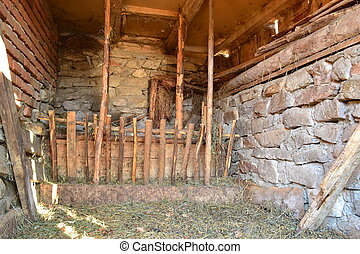 stable - the interior of a stable room in romanian mountains