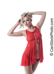 Shot of smiling blond girl in red erotic negligee, close-up