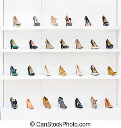 Showcase with female shoes placing in a row in the modern...