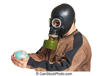 Young man in a gas mask holding a globe