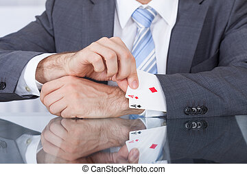 Businessperson Removing Ace From The Sleeve