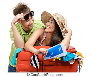 Couple packs suitcase with clothing for travel, isolated on...