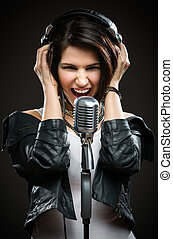 Rock singer with microphone and headphones