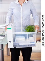Businessperson Carrying Office Supply - Close-up Of...