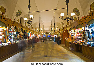 Tourists shop in Sukiennice Cloth Hall in Krakow, Poland