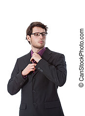 Serious businessman checking his tie - Serious businessman...